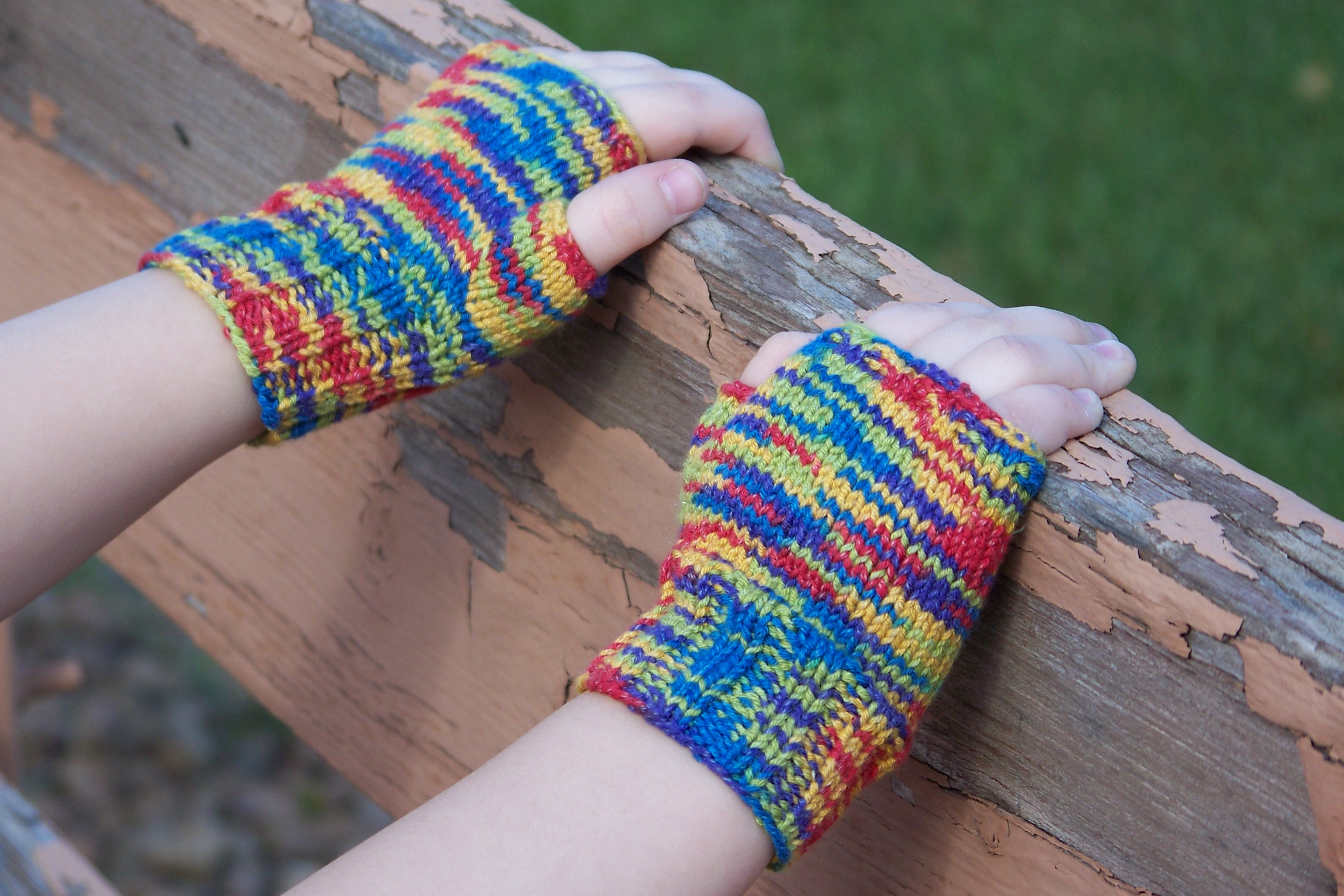 Funtional fingerless wheelchair mittens on fence